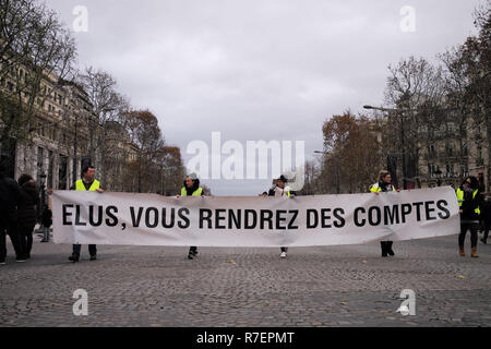 Paris, France. 8th Dec 2018. Demonstrators are walking, showing their sign 'Elected people, you will be accountable' Credit: Roger Ankri/Alamy Live News - Stock Photo