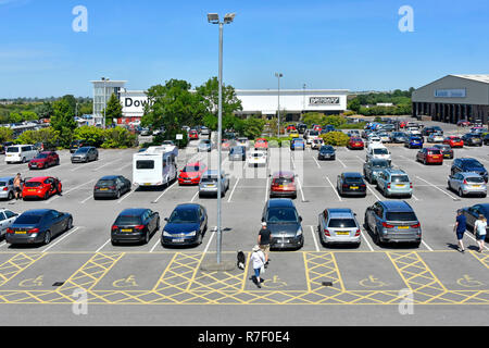 Disabled parking space in free car park at Downtown department store retail superstore warehouse shopping business Grantham Lincolnshire England UK - Stock Photo