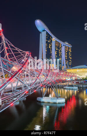 Marina Bay Sands Hotel and the Double Helix Bridge at night, Singapore - Stock Photo