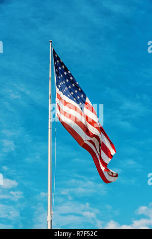American flag against blue sky at summer day - Stock Photo