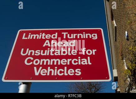 british road sign indicating limited turning space ahead and road not suitable for commercial vehicles, in barnes, surrey, england - Stock Photo