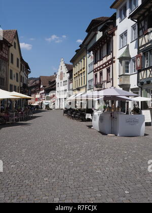 Colorful old houses at street in european Stein am Rhein city on main market square in Switzerland - vertical - Stock Photo
