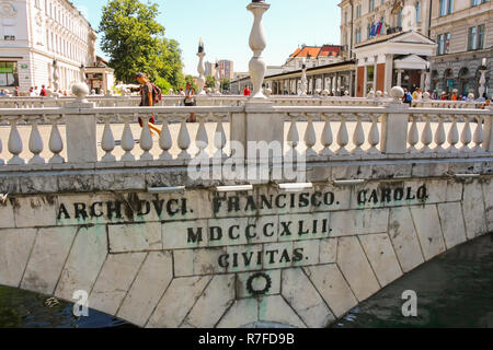 Ljubljana, Slovenia - 2013: Triple Bridge, partly built with Glinica limestone, is a group of three bridges crossing the Ljubljana river - Stock Photo