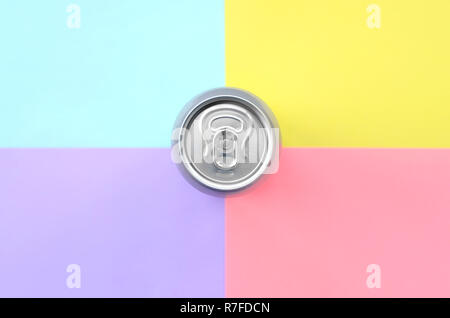 Tin aluminum silver beer can on a pastel background. Minimal flat lay top view. Living coral, violet, blue and yellow colors - Stock Photo