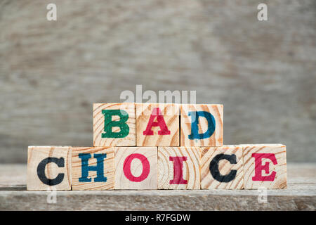 Letter block in word bad choice on wood background - Stock Photo