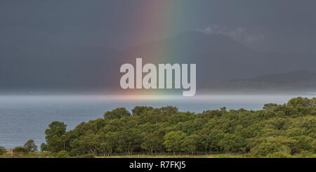Landscape format. Views with rainbow, from Auchnacraig over Grasspoint and towards Oban. Grasspoint, Mull, Isle of Mull, Argyll and Bute, Scotland - Stock Photo