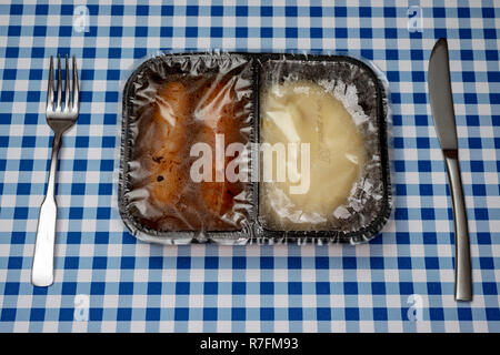 Sausage and mash TV dinner - Stock Photo