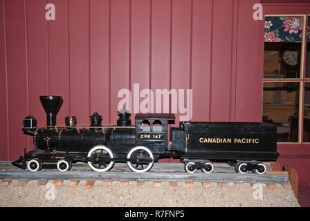 Model of Canadian Pacific Railway (CPR) steam locomotive 147 in Fort Calgary Museum, Calgary, Alberta, Canada - Stock Photo