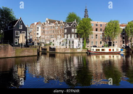 Traditional Dutch houses at Oudeschans canal in Amsterdam, Netherlands - Stock Photo