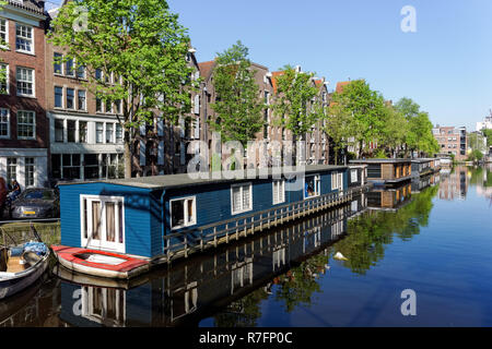 Houseboats on Brouwersgracht canal in Amsterdam, Netherlands - Stock Photo