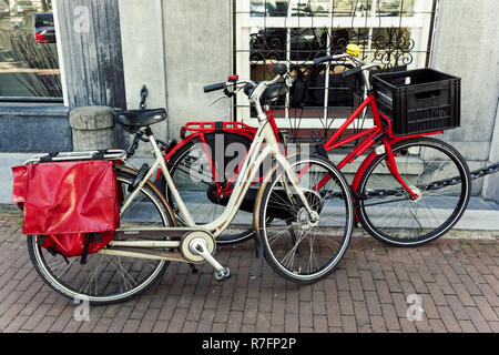 Dutch bicycles parked in Amsterdam, Netherlands - Stock Photo