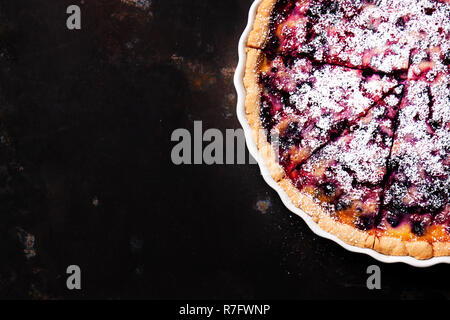 Homemade wild berry pie with sour cream, top view with copy space - Stock Photo