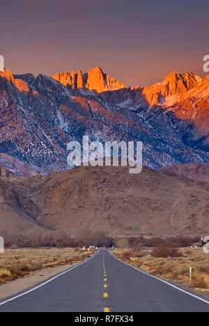 Mount Whitney in Eastern Sierra Nevada with Alabama Hills in foreground at sunrise in winter from State Highway 136 near Lone Pine, California, USA - Stock Photo
