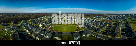 Aerial view of typical American upper middle class single family home suburban community in the East Coast United States with vinyl siding - Stock Photo