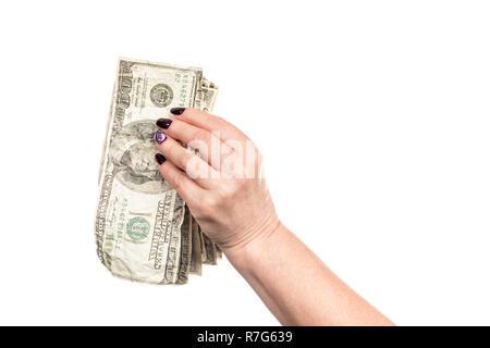 crumpled money in female hand - Stock Photo