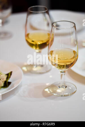 Abstract alcohol art: top view of wine glasses in rows, ready for a degustation - Stock Photo
