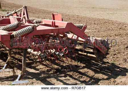 Cultivator prepares spring field for seeding. - Stock Photo