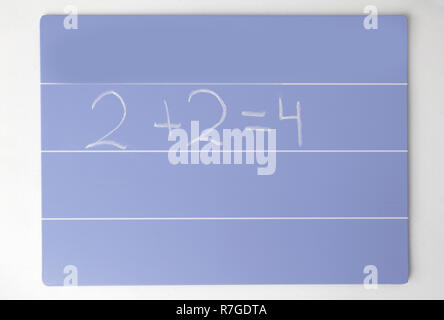 close up. the formula is written for the children's Board on a white background - Stock Photo