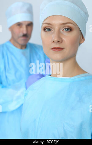 Boss surgeon is examining the operation while medical team are busy of patient. Medicine, healthcare and emergency in hospital - Stock Photo