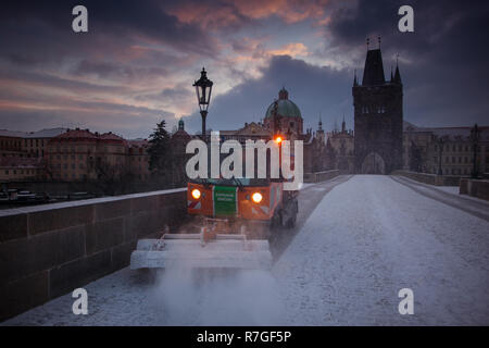 PRAGUE, CZECH REPUBLIC - FEBRUARY 21, 2013: the Saint Charles bridge during the snowfall - Stock Photo