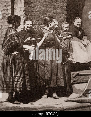 Life for working folk in Victorian days... Women dressed in traditional shawls get together for a knitting party, Liverpool, Merseyside, England - Stock Photo