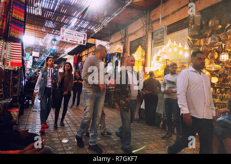 Marrakech souk - local people shopping in the crowded souks, Marrakech medina, Morocco  Africa - Stock Photo