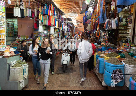 Marrakesh souk - tourists and local people shopping in the crowded souks, Marrakech, Morocco North Africa - Stock Photo