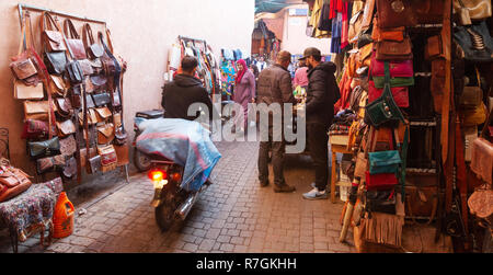 Marrakech street - traders and a motorbike in the souk, Marrakech Medina, Marrakesh, Morocco Africa - Stock Photo