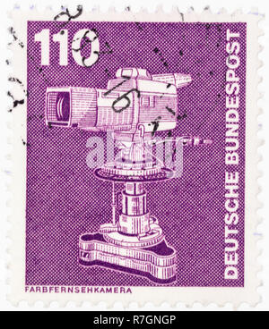 GERMANY - CIRCA 1982: A postage stamp printed in Germany shows color television camera from series industry and technology, circa 1982. - Stock Photo