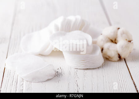 cotton disks pad on white table - Stock Photo