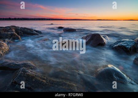 Beautiful December evening by the Oslofjord at Oven, Østfold, Norway. - Stock Photo