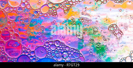 Colored abstract background, oil drops of different sizes placed on a water surface - Stock Photo