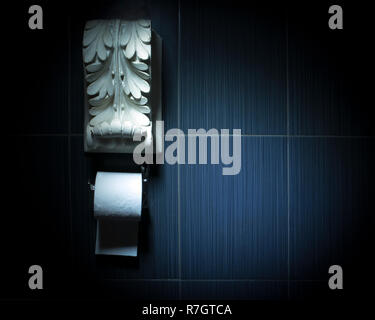 White toilet paper roll on chrome fixture with white antique plaster decoration above. Conceptual toilet design - Stock Photo