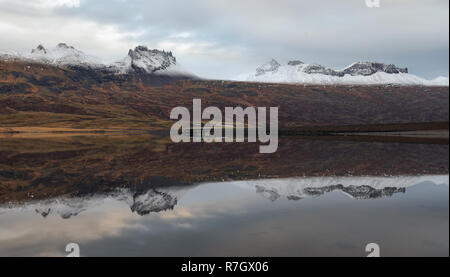 Mountain reflections in Berufjordur, eastern fjords in Iceland - Stock Photo