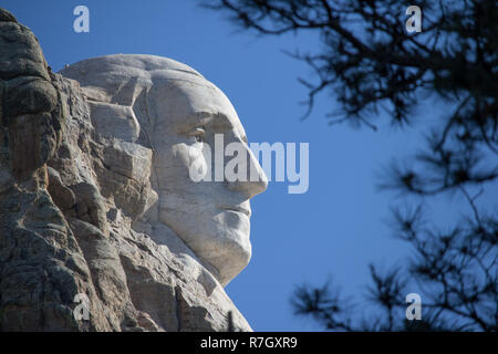 A profile view of George Washington's face on Mount Rushmore in South Dakota. - Stock Photo