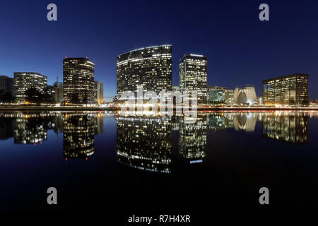 Oakland skyline panoramic view with Lake Merritt Reflections at blue hours. - Stock Photo