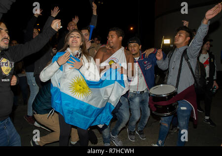 Madrid, Spain. 9th Dec 2018. Hundreds of Argentinian football fans gathered in front of the Santiago Bernarbeu stadium in Madrid for the Copa Libertadores final that took place in Madrid where local authorities embraced 'maximum security'. Credit: Lora Grigorova/Alamy Live News - Stock Photo