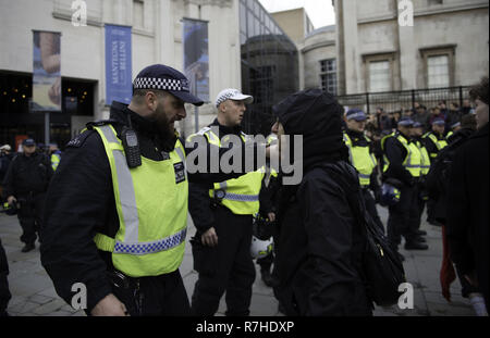 London, Greater London, UK. 9th Dec, 2018. Police officer arguing with a protester during the demonstration against the 'Brexit Betrayal March'.Thousands of people took to the streets in central London to march against the 'Brexit Betrayal March' organised by Tommy Robinson and UKIP. Counter Protesters made their way from Portland Place to Whitehall, where speakers addressed the crowd. During the counter demonstration, there was a strong police presence. A group of counter protesters, who became separated from the main protest, were corralled by police to avoid an encounter - Stock Photo