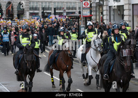 Mounted police officers stand in front of the march against Tommy Robinson.  Thousands of people took to the streets in central London to march against the 'Brexit Betrayal March' organised by Tommy Robinson and UKIP. Counter Protesters made their way from Portland Place to Whitehall, where speakers addressed the crowd. During the counter demonstration, there was a strong police presence. A group of counter protesters, who became separated from the main protest, were corralled by police to avoid an encounter with a group of Tommy Robinson / UKIP supporters. - Stock Photo