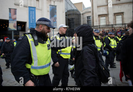 Police officer arguing with a protester during the demonstration against the 'Brexit Betrayal March'.  Thousands of people took to the streets in central London to march against the 'Brexit Betrayal March' organised by Tommy Robinson and UKIP. Counter Protesters made their way from Portland Place to Whitehall, where speakers addressed the crowd. During the counter demonstration, there was a strong police presence. A group of counter protesters, who became separated from the main protest, were corralled by police to avoid an encounter with a group of Tommy Robinson / UKIP supporters. - Stock Photo