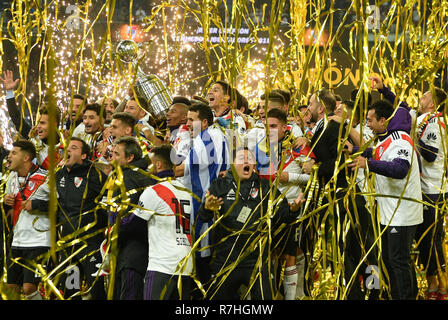 Madrid, Spain. 9th Dec, 2018. Players and staff of River Plate celebrate their victory after the second round of Copa Libertadores final between River Plate and Boca Juniors in Madrid, Spain, on Dec. 9, 2018. River Plates won 3-1 in the second round and 5-3 in total to claim the title. Credit: Guo Qiuda/Xinhua/Alamy Live News - Stock Photo