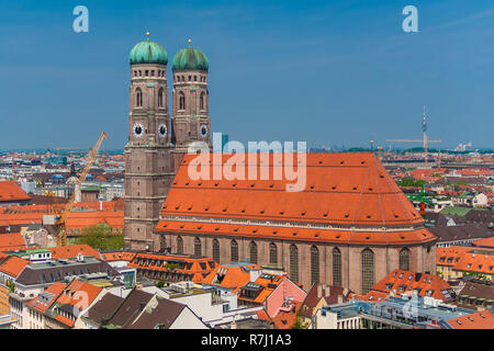 Picturesque cityscape view with the famous Munich Cathedral, also called Cathedral of Our Dear Lady (Frauenkirche), a church and landmark of Munich... - Stock Photo
