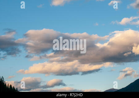 Cumulus Cloud formations with blue sky background. Photographed in Stubai, Tyrol, Austria in September - Stock Photo