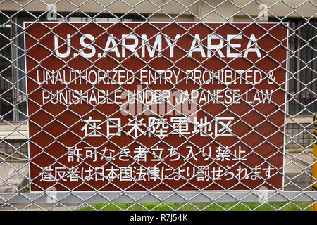US Army military base in Tokyo, Japan - no trespassing sign on a steel fence - Stock Photo