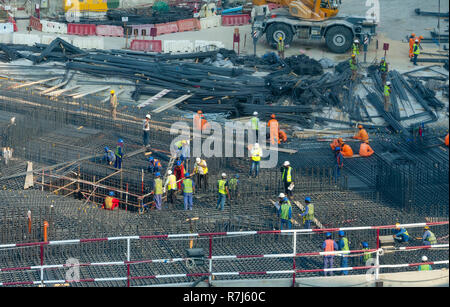 Workers at a construction site in UAE - Stock Photo