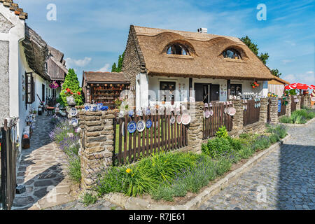 Old farmhouse with thatched roof. Cups and plates are sold, Tihany, Veszprem county, Central Transdanubia, Hungary, Europe - Stock Photo