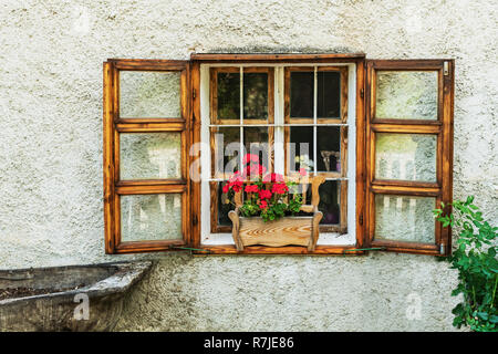 Wooden window with flower box and red geraniums on a house in Tihany, Veszprem county, Central Transdanubia, Hungary, Europe - Stock Photo