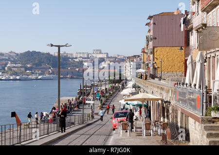 Ribeira of Porto seeing the street market and the city of Vila Nova de Gaia on the other side of the Douro river in a beautiful autumn morning on 27 N - Stock Photo