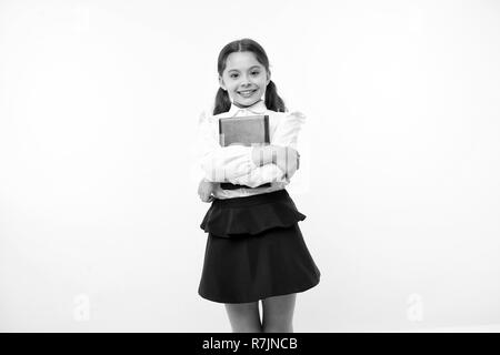 Happy girl hold book on yellow background. Little schoolgirl smile with textbook. Fashion bookworm. First school day. Learning is my game. - Stock Photo
