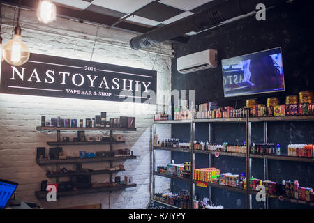 Ufa, Russia, South Vape Shop, 5 July, 2018: E-liquid e-juice High vape for electronic cigarette vaping device , on counter in smoke vapor in vape bar in bottles. - Stock Photo